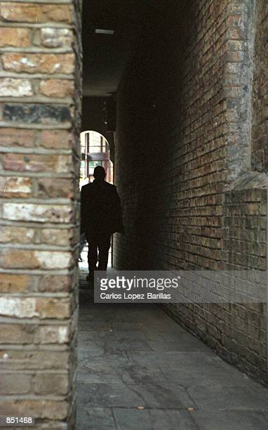 A man walks a narrow alleyway leading to Liverpool Street August 2 2000 near the area of Aldgate/ Whitechapel East London United Kingdom This is...