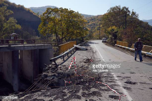 Man walks across a bridge connecting Armenia with Nagorno-Karabakh which was hit by an Azeri missile - the video of which started to circulate early...
