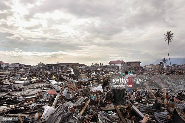 A man walks across destroyed buildings January 10 2005 in Banda Aceh Indonesia The province of Aceh one of the worst hit regions in the December 26...