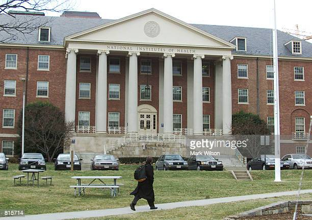 Man walks across the campus of the National Institutes of Health, March 9, 2001 in Bethesda, MD.
