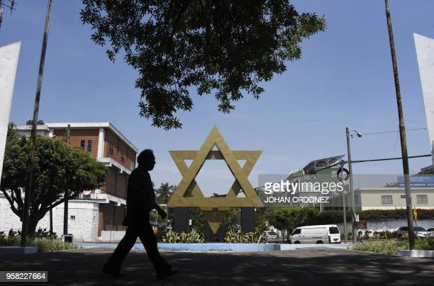 A man walks across the Israel square in Guatemala City on May 11 2018 Guatemala will install its Israeli embassy in Jerusalem just two hours after...