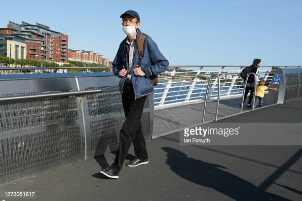 A man walks across the River Tyne on the Gateshead Millenium Bridge on September 17 2020 in Newcastle upon Tyne England Almost two million people in...