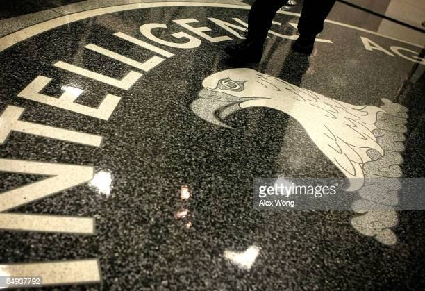 A man walks across the seal of the Central Intelligence Agency at the lobby of the Original Headquarters Building at the CIA headquarters February 19...