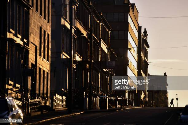 A man walks across West Regent street during the lockdown due to the coronavirus pandemic on April 21 2020 in Glasgow United Kingdom The British...