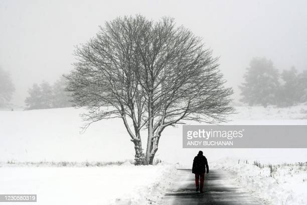 Man walks along a path at Gleneagles golf course in Gleneagles as heavy snow fell on parts of Scotland on January 14, 2021.