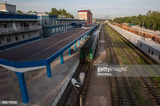 A man walks along a platform past trains at Dushanbe Station in Dushanbe Tajikistan on Sunday April 22 2018 Flung into independence after the Soviet...