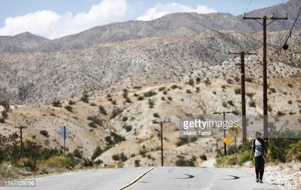 A man walks along a road in the Coachella Valley on May 7 2019 in Desert Hot Springs California California's Fourth Climate Change Assessment found...