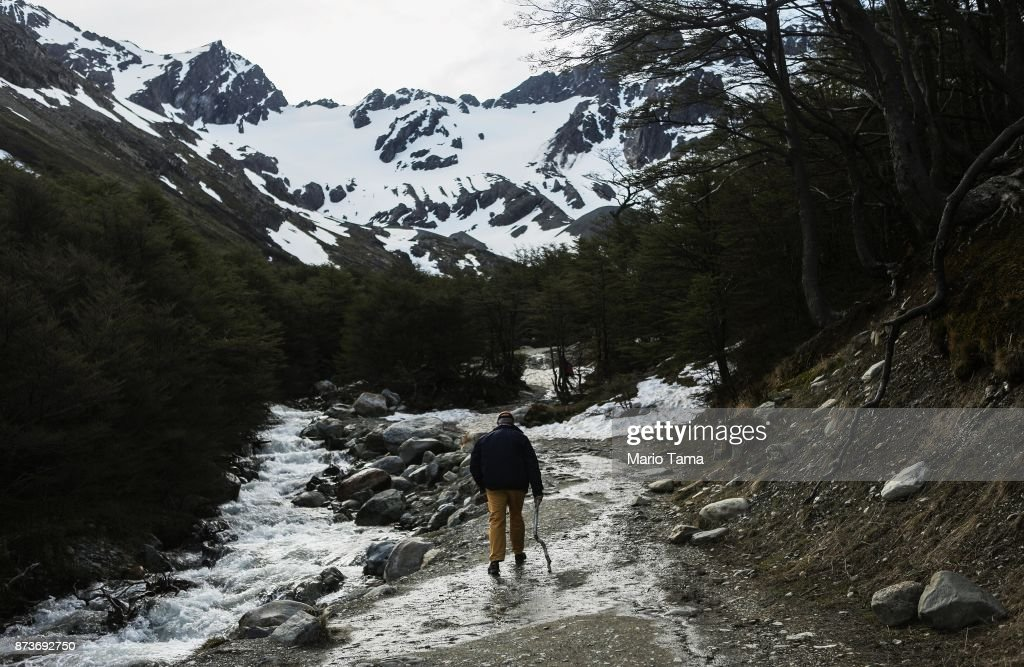 A man walks along a runoff stream below the retreating Martial Glacier on November 9, 2017 in Ushuaia, Argentina. Ushuaia is situated along the southern edge of Tierra del Fuego, in the Patagonia region, and is commonly known as the 'southernmost city in the world'. The city's main fresh water supply comes from the retreating Martial Glacier, which may be at risk of disappearing. In a 2015 report, warming temperatures led to the loss of 20 percent of the mass and surface of glaciers in Argentina over the previous 50 years, according to Argentina's Institute of Nivology, Glaciology and Environmental Sciences (IANIGLIA). Ushuaia and surrounding Tierra del Fuego face other environmental challenges including a population boom leading to housing challenges following an incentivized program attracting workers from around Argentina. Population in the region increased 11-fold between 1970 and 2015 to around 150,000. An influx of cruise ship tourists and crew, many on their way to Antarctica, has also led to increased waste and pollution in the area sometimes referred to as 'the end of the world'.