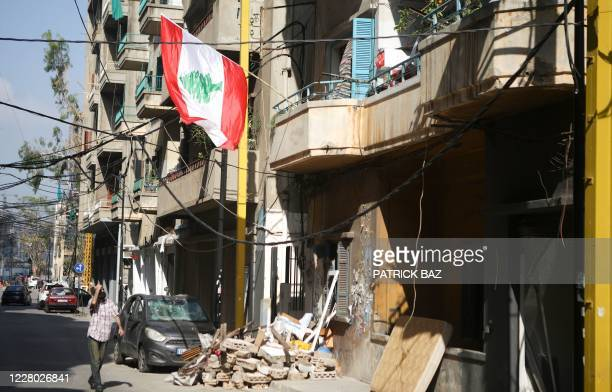 Man walks along a street in the partially destroyed neighbourhood of Mar Mikhael on August 13 more than a week after a massive blast in the nearby...