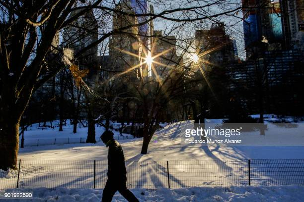A man walks along Central Park during freezing temperatures on January 06 2018 in New York City The extreme conditions suffered across the United...