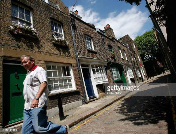 Man walks along Little Green Street in Kentish Town on June 10, 2008 in north London, England. The small cobbled street of terraced houses, built in...