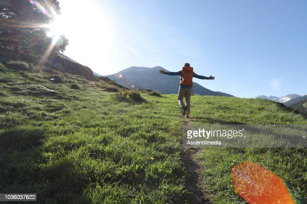 man walks along pathway in celebratory mood - andorra stock pictures, royalty-free photos & images