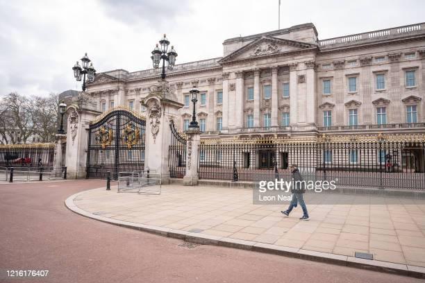 Man walks along the deserted pavements around Buckingham Palace on April 01, 2020 in London, United Kingdom . The Coronavirus pandemic has spread to...