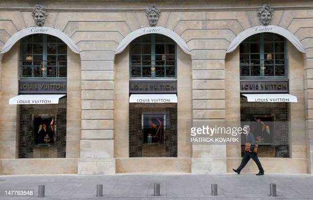A man walks along the first Louis Vuitton jewellery store opened in the prestigious jewellery area place Vendome on July 3 2012 in Paris Louis...