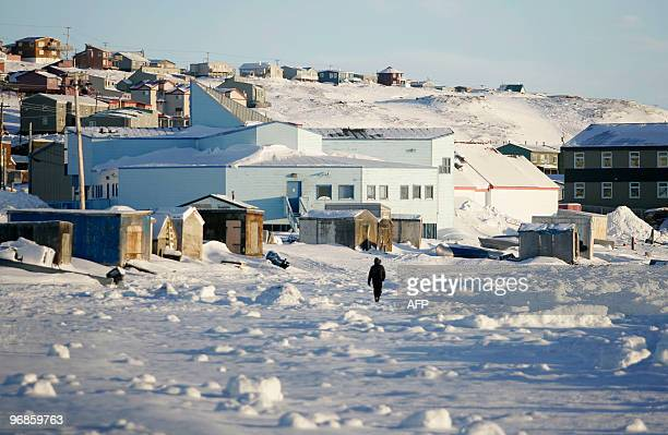 A man walks along the shoreline in Iqaluit Canada February 4 2010 where the Group of Seven finance ministers will start meeting on February 5 AFP...