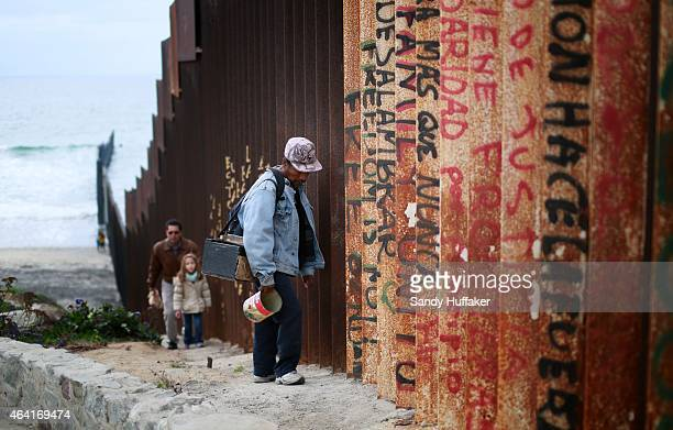 A man walks along the USMexico border wall on February 22 2015 in Tijuana Mexico Senior Republican senators said they expected Congress will avoid a...