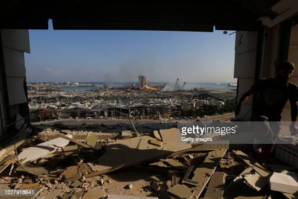 Man walks amid a ruined building near the city's port, devastated by an explosion a day earlier, on August 5, 2020 in Beirut, Lebanon. As of...