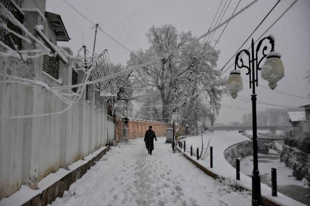 IND: Snowfall In Kashmir
