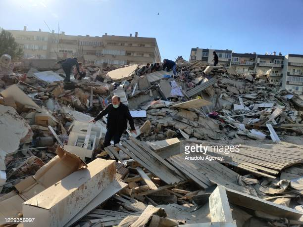Man walks among debris of collapsed buildings after a magnitude 6.6 quake shook Turkey's Aegean Sea coast, in Izmir, Turkey on October 30, 2020.
