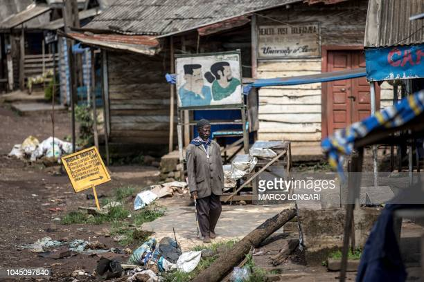 A man walks among shuttered stores in a district of the majority Englishspeaking South West province capital Buea on October 3 2018