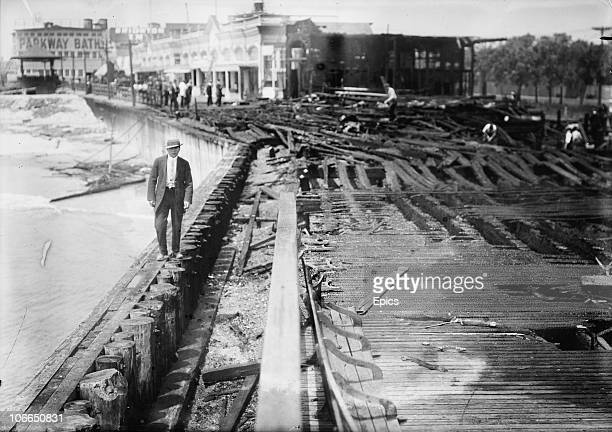 A man walks among the damage along Brighton Beach after a fire took hold there New York 1912
