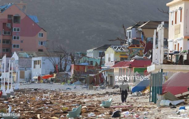 A man walks among the destruction left by Hurricane Irma at the Phillipsburg Town Beach on September 11 2017 in Philipsburg St Maarten The Caribbean...