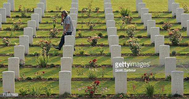 A man walks among the graves of unknown soldiers killed in the Battle of Somme at the Thiepval Memorial and AngloFrench cemetery as the 90th...