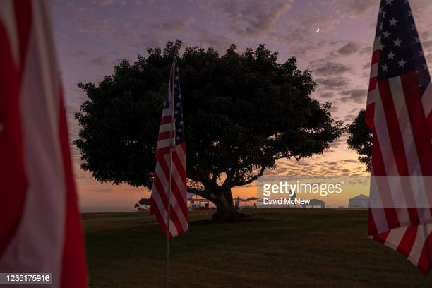 Man walks among the nearly 3,000 flags flying on the eve of the 20th anniversary of the September 11 terror attacks in Alumni Park at Pepperdine...