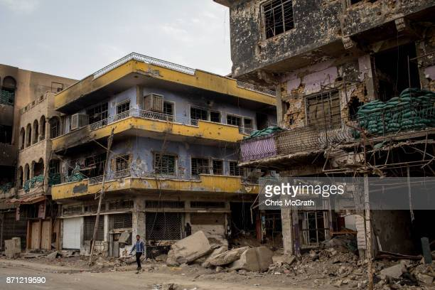A man walks amongst damaged buildings on November 6 2017 in Mosul Iraq Five months after Mosul Iraq's secondlargest city was liberated from ISIL in a...