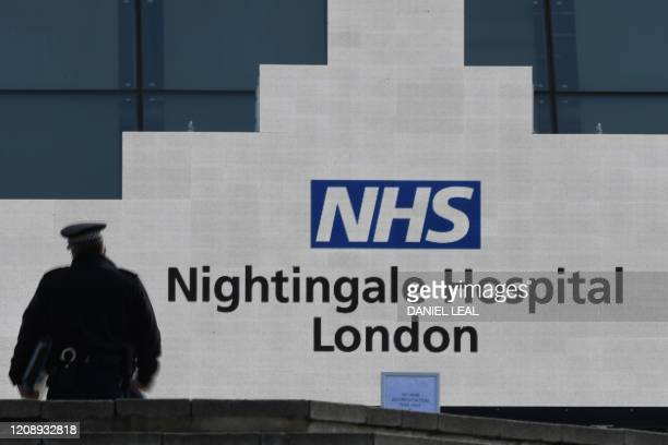 A man walks at the NHS Nightingale Hospital on the site of the ExCeL London exhibition centre in London on April 2 which is operating as a field...
