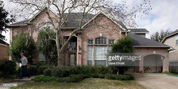 A man walks away from the home of astronaut Lisa Marie Nowak after placing a note by the dooron February 7 2006 in Houston Texas Nowak has been...
