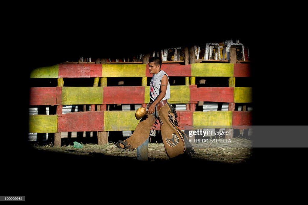 A man walks away from the ring after riding a bull during a festival commemorating Managua's patron saint Santo Domingo de Guzman, popularly known as 'Minguito', in Managua on August 6, 2009. AFP PHOTO/Alfredo Estrella