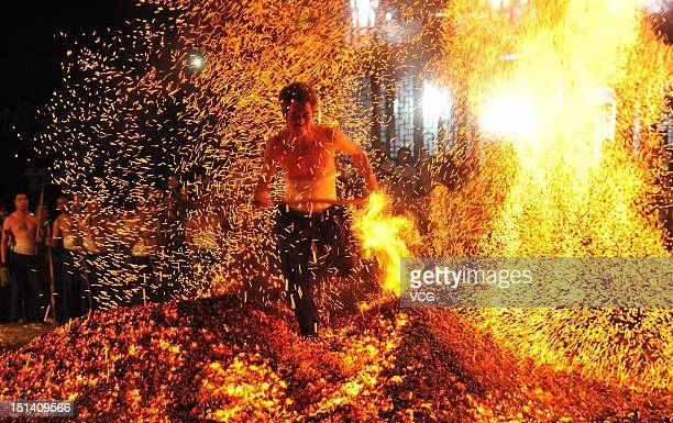 A Man Walks Barefoot On Burning Embers During A Traditional Firewalking Ceremony In Hope Of Avoiding