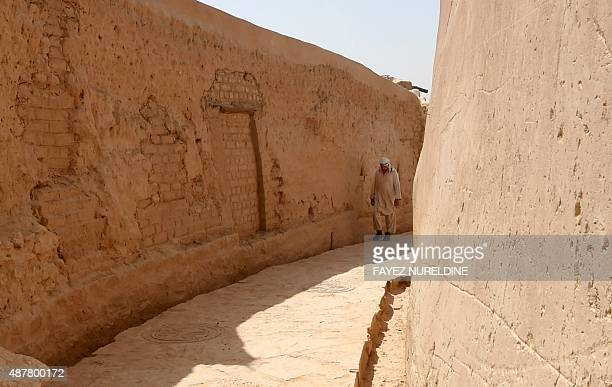 A man walks between old buildings in the historical UNESCO World Heritage Atturaif district on the outskirts of Riyadh on July 13 which is part of a...