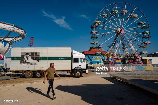 Man walks between the rides at the Luna Park at Secca dei Pali in Molfetta on 2 September 2021. On the occasion of the patronal feast of Our Lady of...