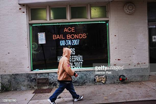 A man walks by a bail bonds store on October 20 2011 in Reading Pennsylvania Reading a city that once boasted numerous industries and the nation's...