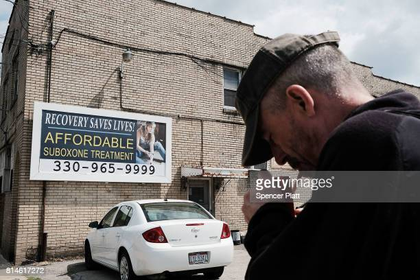 A man walks by a billboard for a drug recovery center in Youngstown on July 14 2017 in Youngstown Ohio Youngstown a city that was once one of the...