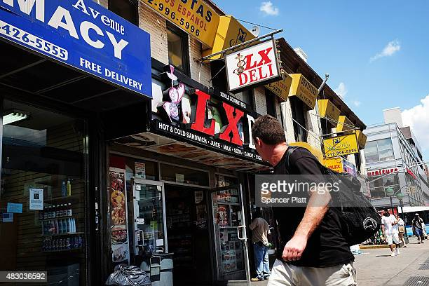 Man walks by a bodega where New York City police recently confiscated over 2,000 packets of synthetic marijuana in East Harlem on August 5, 2015 in...