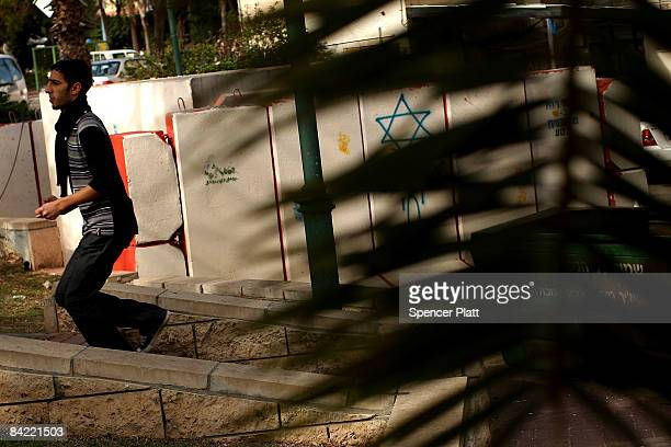 Man walks by a bomb shelter January 9, 2009 in Sderot, Israel. The southern town of Sderot has had hundreds of Hamas fired kassam rockets directed at...