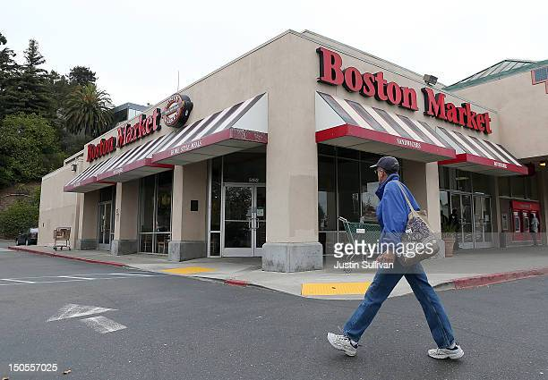 A man walks by a Boston Market restaurant on August 21 2012 in Oakland California Restaurant chain Boston Market announced today that it plans to...