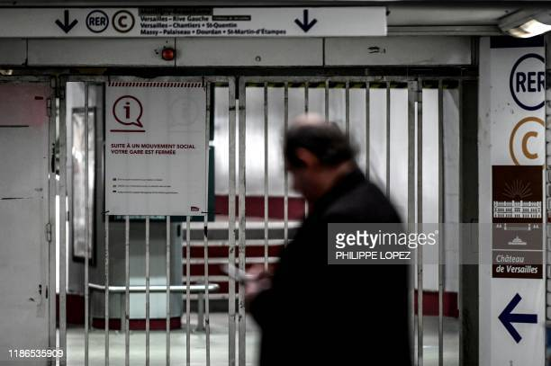 A man walks by a closed RER gate during a strike of Paris public transports operator RATP employees over French government's plan to overhaul the...