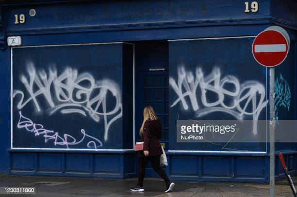 Man walks by a closed shop in Dublin city center during Level 5 Covid-19 lockdown. On Tuesday, 26 January in Dublin, Ireland.