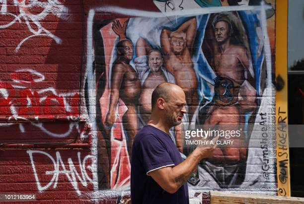 A man walks by a graffiti mural in the Williamsburg section of Brooklyn New York on August 6 2018 by New Yorkbased artist Angela China with US...