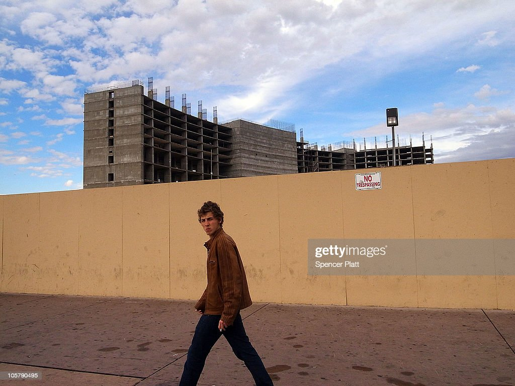 A man walks by a halted construction project on Las Vegas Boulevard on October 20, 2010 in Las Vegas, Nevada. Nevada once had among the lowest unemployment rates in the United States at 3.8 percent but has since fallen on difficult times. Las Vegas, the gaming capital of America, has been especially hard hit with unemployment currently at 14.7 percent and the highest foreclosure rate in the nation. Among the sparkling hotels and casinos downtown are dozens of dormant construction projects and hotels offering rock bottom rates. As the rest of the country slowly begins to see some economic progress, Las Vegas is still in the midst of the economic downturn.
