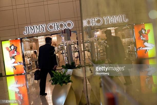 56497d8f512 A man walks by a Jimmy Choo Ltd retail store in a shopping mall in Hong