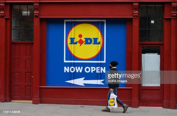 Man walks by a LIDL store in Dublin city center, during the COVID-19 pandemic lockdown. Level 5 lockdown restrictions are set to be extended by Irish...