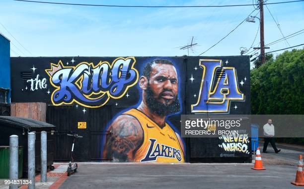 A man walks by a mural of LeBron James in a Los Angeles Lakers jersey in Venice California on July 9 2018 It was originally revealed July 6 and then...