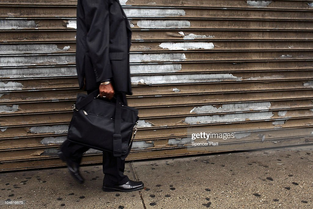 A man walks by a shuttered store in an economically depressed neighborhood on September 28, 2010 in the Brooklyn borough of New York City. A new report released by the U.S. Census Data shows that the income gap between Americans is greater than at any other time on record. The report found that the top-earning 20% of Americans received 49.4% of the country's total income. Conversely, those living below the poverty line earned 3.4% of the national income. This is the highest disparity of wealth among all Western industrialized nations.