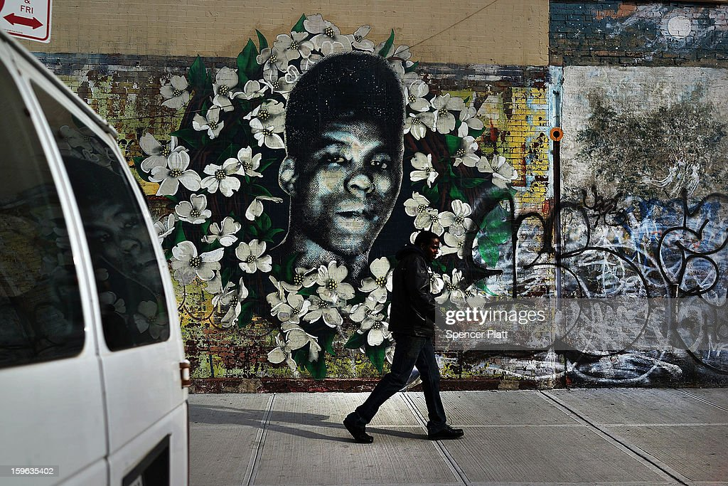 A man walks by a walks by a graffiti memorial in memory of Yusef Hawkins, a 16-year-old African American youth who was shot to death on August 23, 1989 in Bensonhurst, on January 17, 2013 in the Brooklyn borough of New York City. Visual memorials honoring residents who in many cases met violent ends decorate many Brooklyn neighborhoods. New York Governor Andrew Cuomo recently signed into law the New York Secure Ammunition and Firearms Enforcement Act, one of the toughest gun laws in the country.
