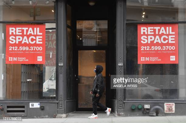 A man walks by an available retail space on Broadway SoHo's popular shopping area on May 4 2020 in New York City